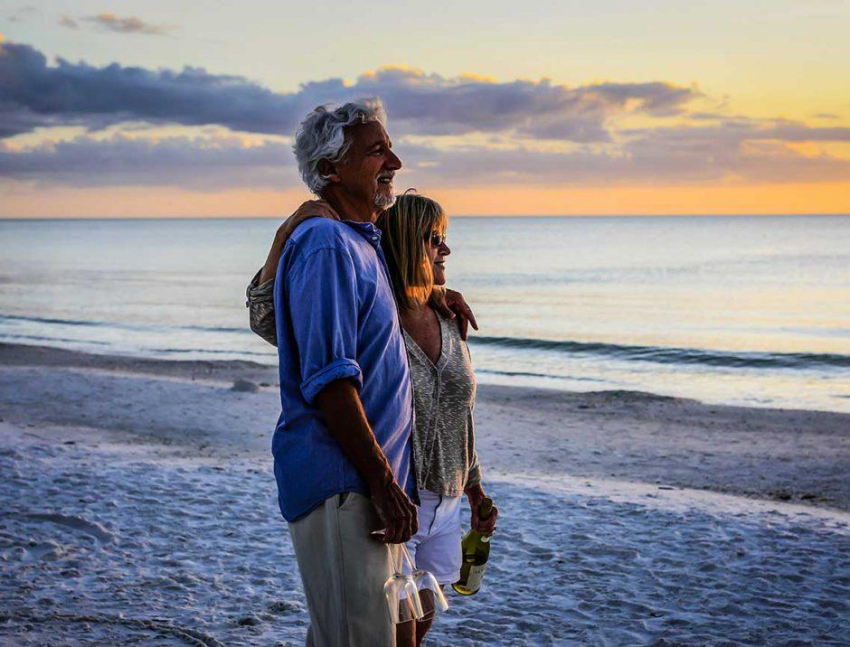 Senior couple strolling on Florida beach
