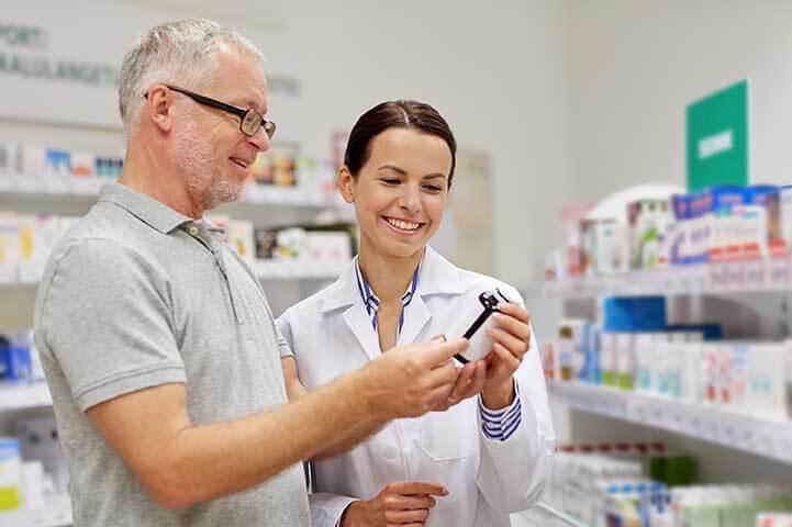 Senior receives help from pharmacist