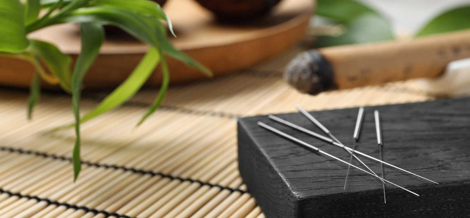 Board with needles for acupuncture on bamboo mat