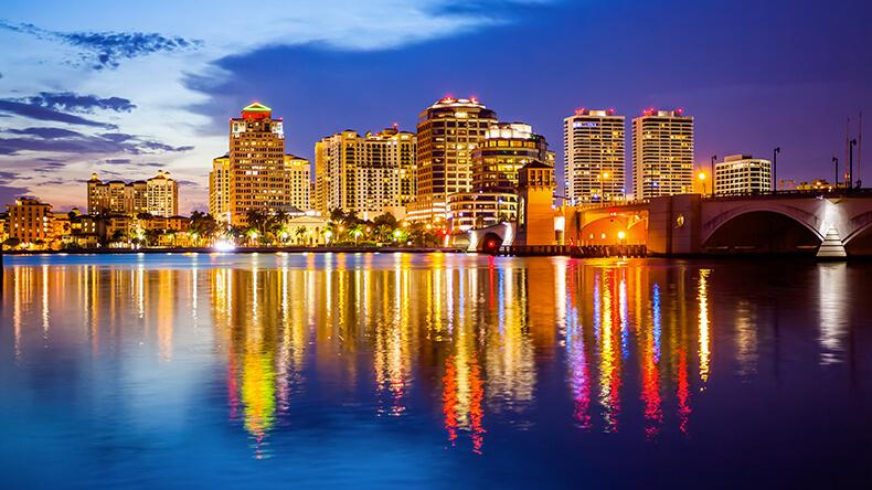 West Palm Beach, Florida skyline and city lights as night falls