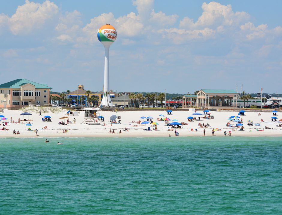 Beach goers at Pensacola Beach in Escambia County, Florida on th