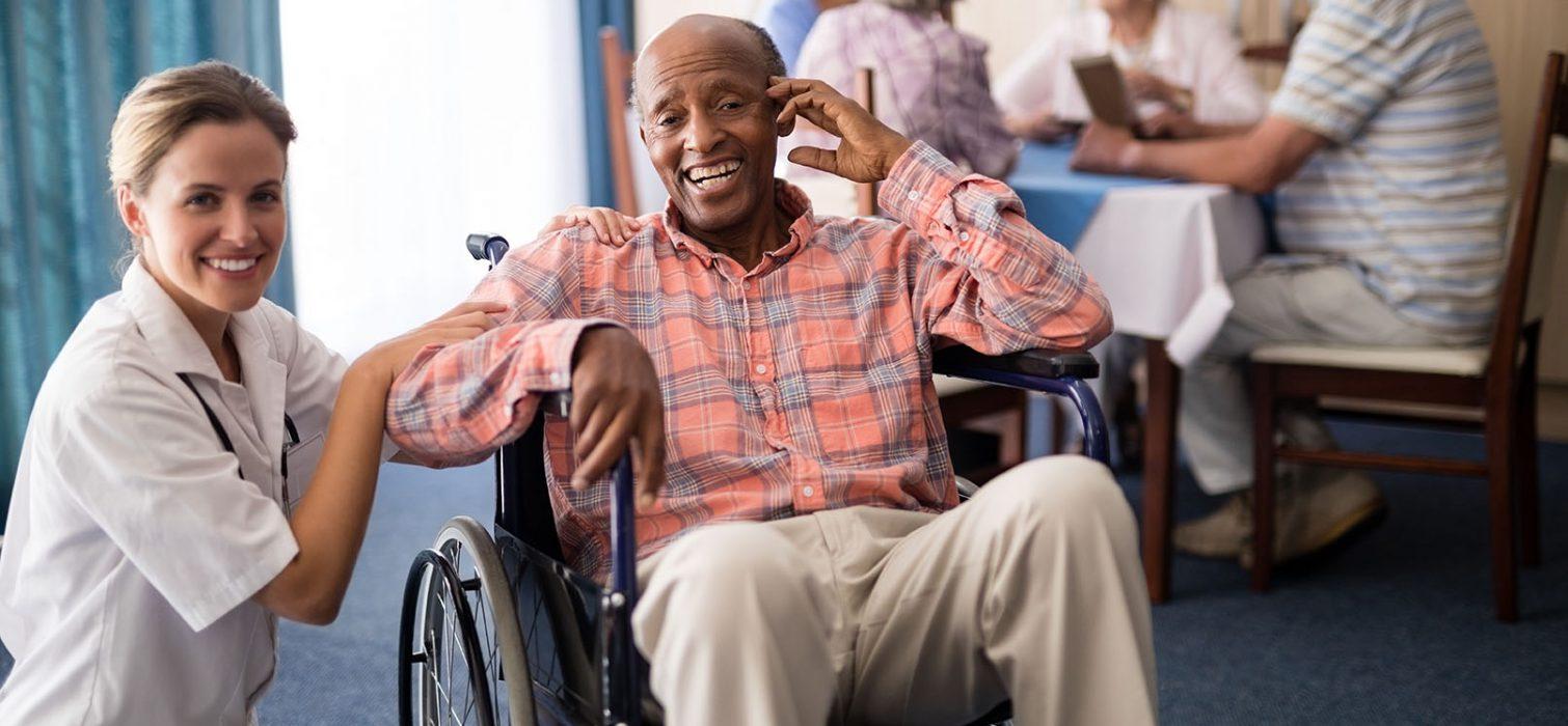 Portrait of cheerful disabled senior man sitting on wheelchair